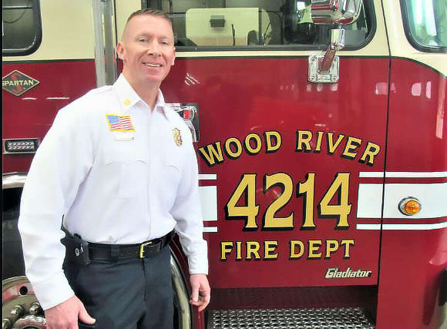 Wood River Fire Chief Wade Stalhut stands next to one of the department's trucks on Thursday. Stalhut was 17 when he started his firefighting career with his father for the Holiday Shores Fire Protection District. Photo: Dyaln Suttles | The Telegraph