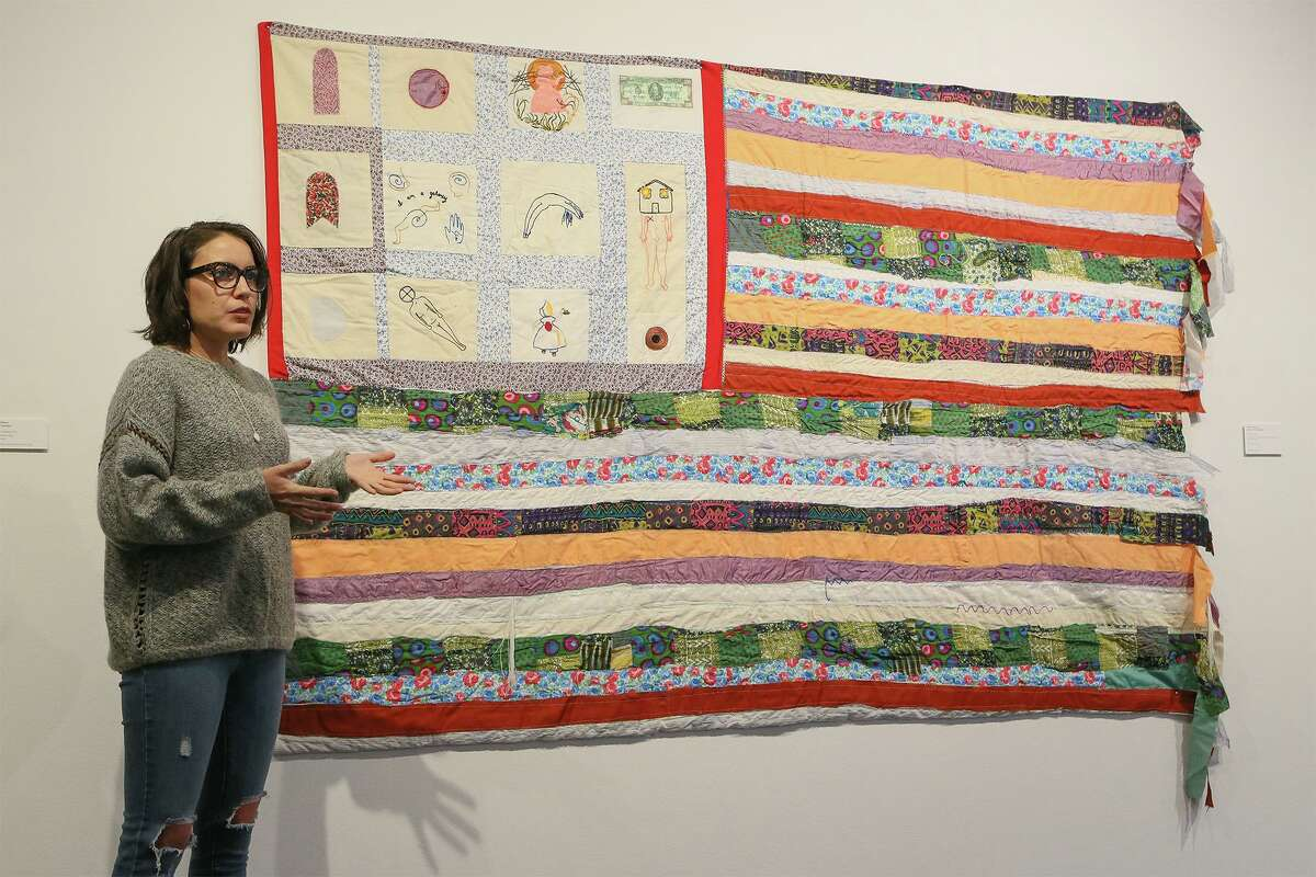 """Visual aritst Jenell Esparza, shown with her hand-sewn quilt """"Continent"""" for an exhibit at Artpace, has received a $5,000 grant from the Luminaria Artist Foundation."""
