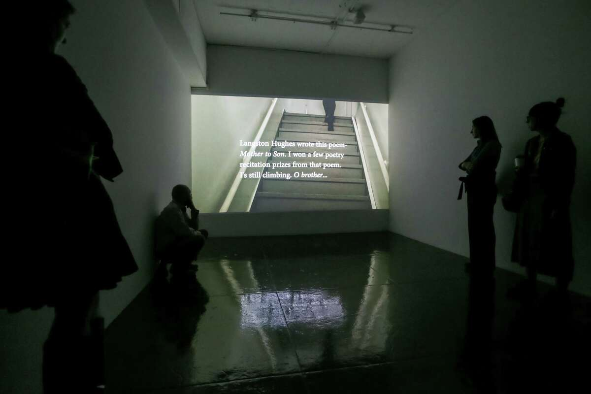 """Visitors watch a video titled """"Meesh"""" (2017) by Autumn Knight during a walk-through of """"Visibilities: Intrepid Women of Artpace."""""""