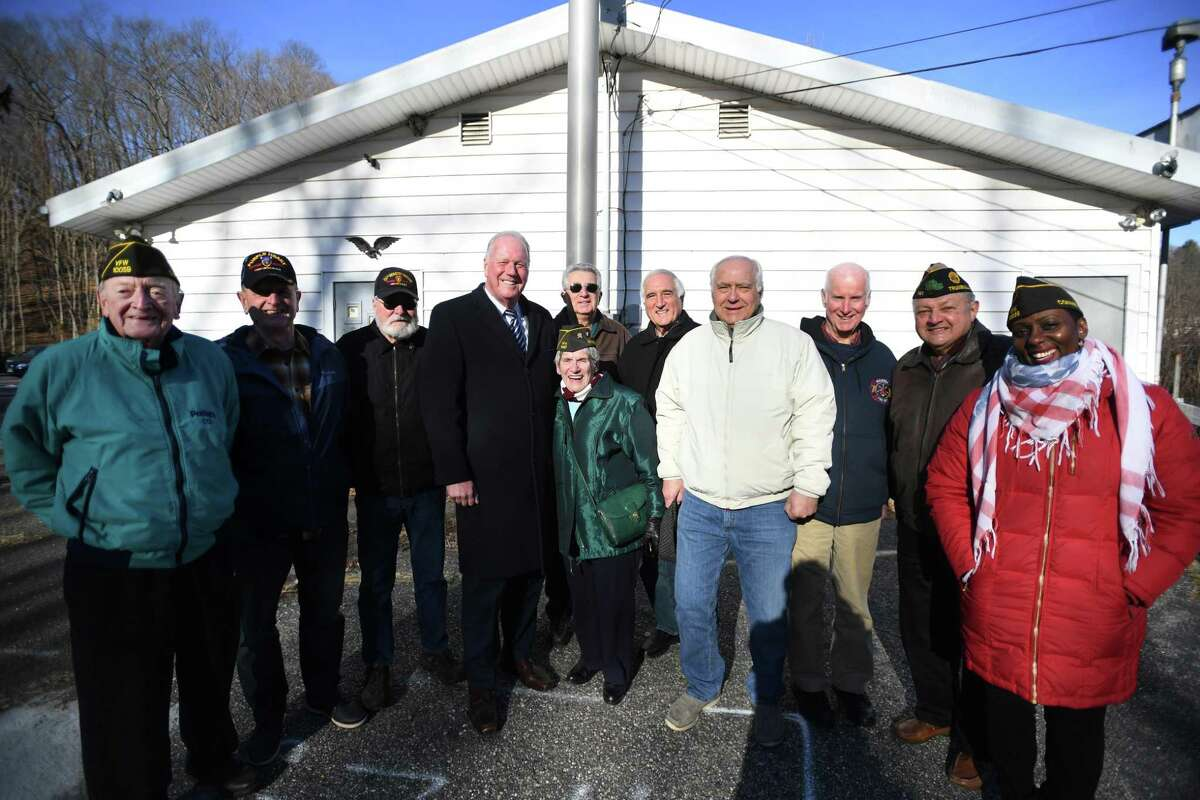 From left; Veterans Bill Powell, John Alberghini, Graham Bisset, Ray Baldwin, Vanessa Marshall, Ron Foligno, Dan Sacco, Ernie Foito, David Weir, Joe Montanaro, and Juliet Taylor outside the Trumbull VFW/American Legion building at 1 Veterans Circle in Trumbull, Conn. on Thursday, January 09, 2020. A new building is scheduled for construction on the site later this year.