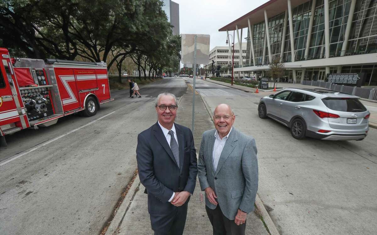 Lonnie Hoogeboom (left) and Bob Euryand of the Houston Downtown Redevelopment Authority pose for a photo on Bagby Street Friday, Jan. 10, 2020, in Houston.