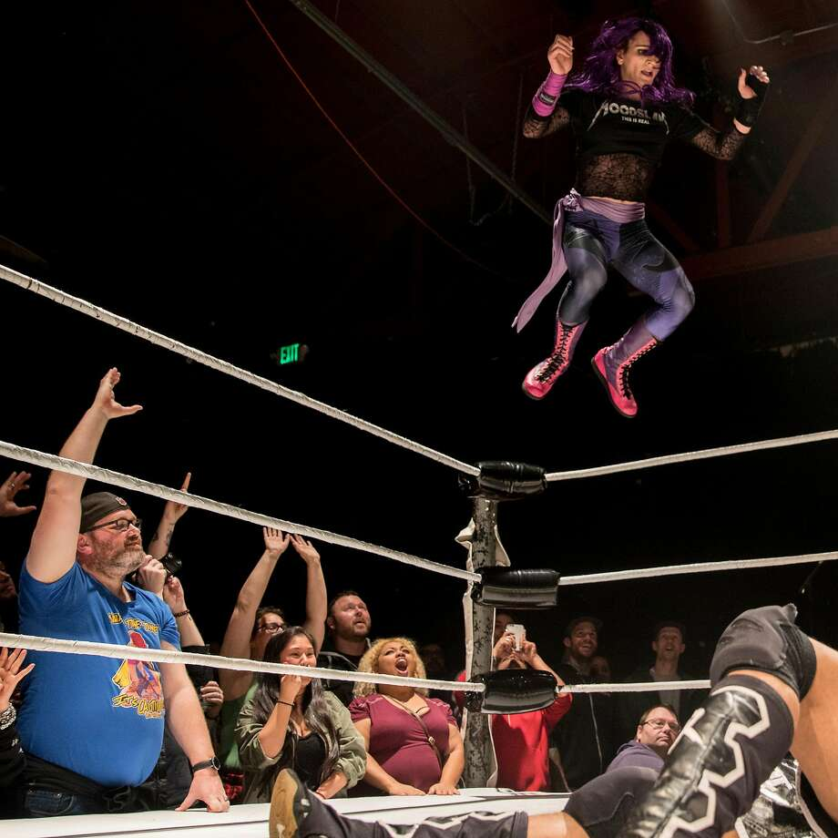 Sam Khandaghabadi, known in the ring as Dark Sheik, bodyslams D-Rogue while facing off during a Hoodslam event at Oakland Metro Operahouse in Oakland, Calif. Friday, Dec. 6, 2019. Photo: Jessica Christian / The Chronicle 2019