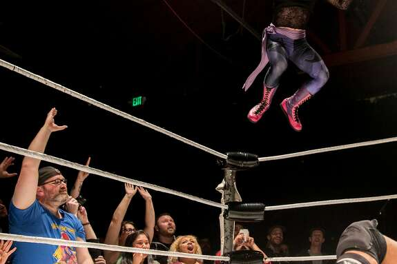 Sam Khandaghabadi, known in the ring as Dark Sheik, bodyslams D-Rogue while facing off during a Hoodslam event at Oakland Metro Operahouse in Oakland, Calif. Friday, Dec. 6, 2019.