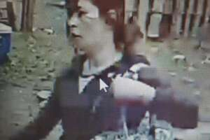 Redding authorities are trying to identify this woman, who was seen on surveillance video beating, kicking and biting a dog.