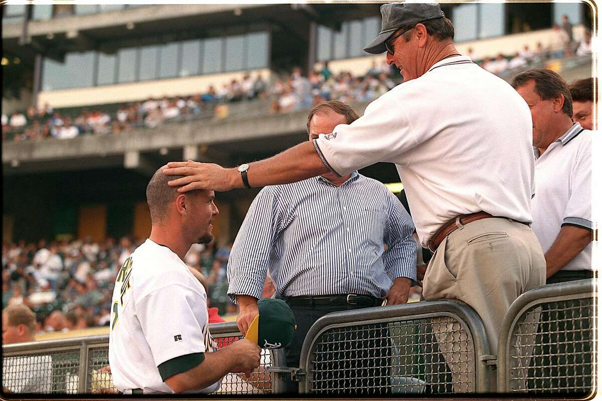 SPRAGUE 2/C/03AUG98/EF/PDS---A's third baseman Ed Sprague got a pat on the head by his father Ed Sprague Sr. before his second game with the A's. Chronicle Photo By:Peter DaSilva