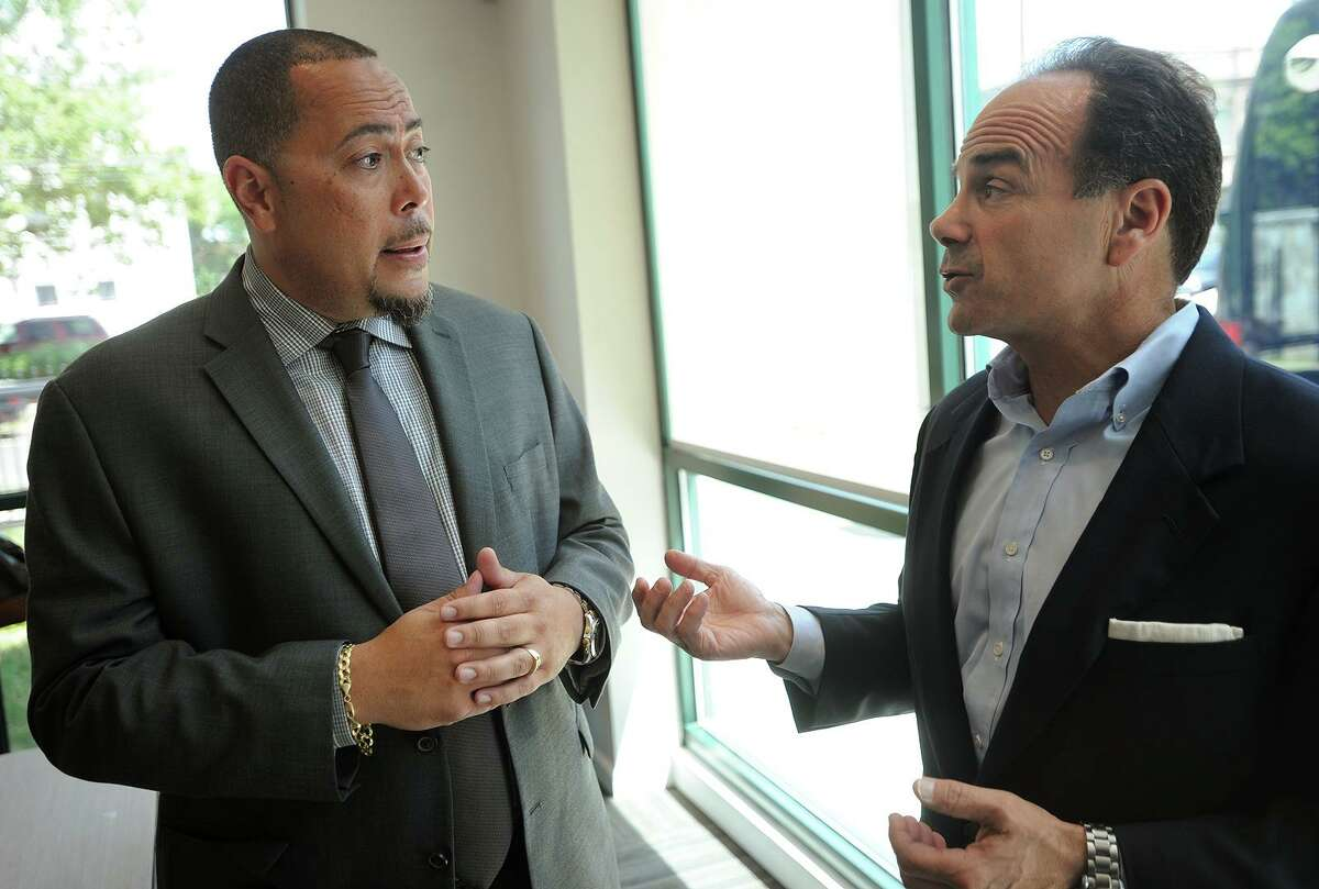A+ Technology & Security Solutions New England headquarters Director Jorge Garcia, left, talks with Bridgeport Mayor Joe Ganim at the grand opening of the company's new satellite offices at 1027 Fairfield Avenue in Bridgeport, Conn. on Tuesday, July 12, 2016. The Long Island, NY based company is the security provider for the City of Bridgeport.