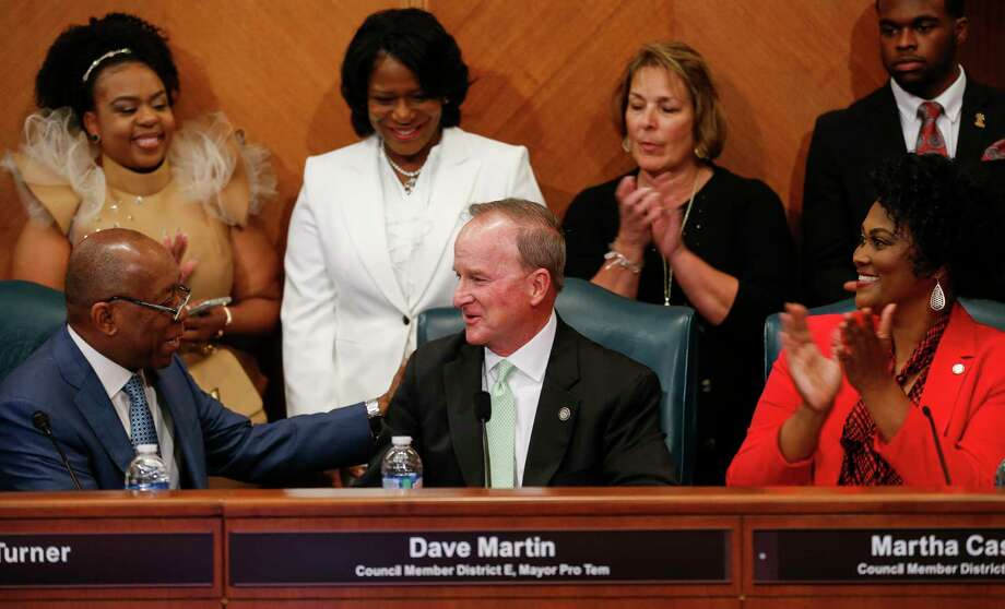 Mayor Sylvester Turner congratulates Dave Martin, Council Member District E, after being named Mayor Pro Term during the council meeting at City Hall Thursday, Jan. 2, 2020, in Houston. Photo: Godofredo A. Vásquez, Houston Chronicle / Staff Photographer / © 2020 Houston Chronicle