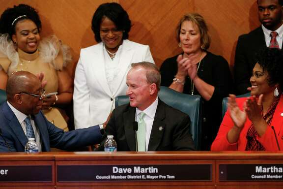 Mayor Sylvester Turner congratulates Dave Martin, Council Member District E, after being named Mayor Pro Term during the council meeting at City Hall Thursday, Jan. 2, 2020, in Houston.