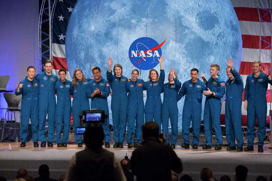 Thirteen first class of astronaut candidates, including Sugar Land native, Loral O'Hara, six from right, under the Artemis program pose for a photograph during their graduation ceremony at the Johnson Space Center on Friday, Jan. 10, 2020, in Houston. After completing more than two years of training, the astronauts are now eligible for assignments, including going to the International Space Station, Artemis missions to the Moon and missions to Mars. Photo: Yi-Chin Lee, Houston Chronicle / Staff Photographer / © 2020 Houston Chronicle