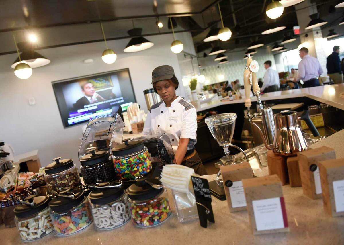 Roneshia Maize makes a drink at Liquidity, a coffee bar in the new 130-seat Terrace Café at 3 Stamford Plaza on Tresser Boulevard in Stamford, Conn., on Thursday, Jan. 9, 2020. Office-building owners like RFR Realty see major renovations as critical to keeping and attracting tenants in a local market still saddled with many vacancies