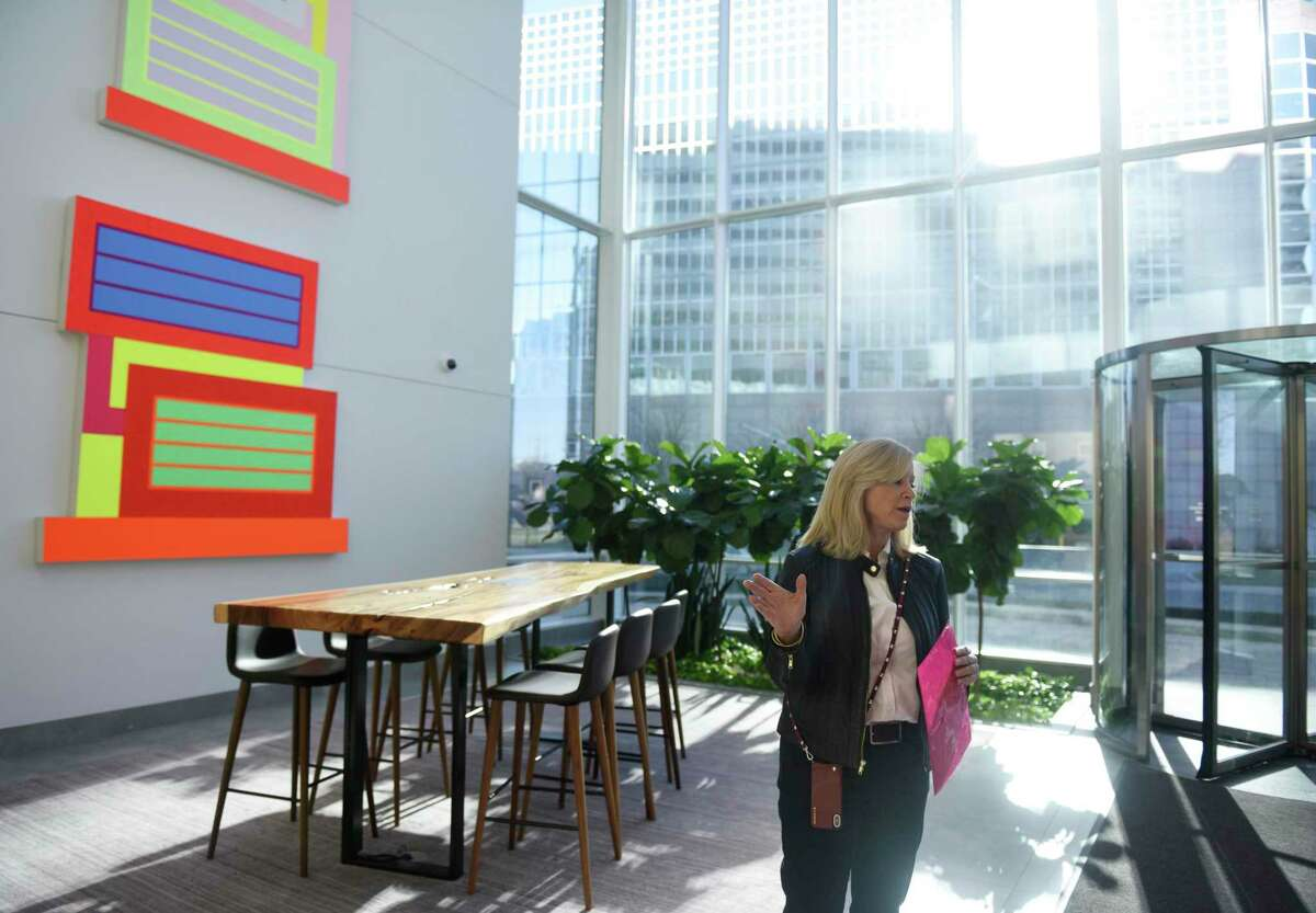 RFR Realty's Stamford portfolio director Margaret Carlson shows the impressive lobby of 4 Stamford Plaza on Elm Street in Stamford, Conn., on Thursday, Jan. 9, 2020. Office-building owners like RFR Realty see major renovations as critical to keeping and attracting tenants in a local market still saddled with many vacancies