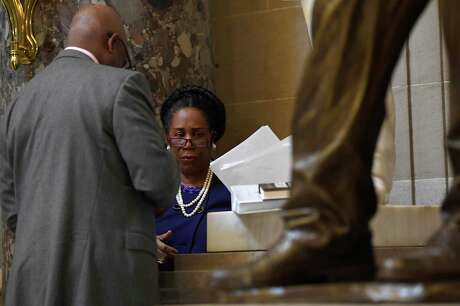 Rep. Sheila Jackson Lee, D-Texas, goes over notes while standing in Statuary Hall on Capitol Hill in Washington, Dec. 18, 2019.