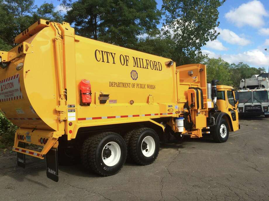 The City of Milford has a fleet of these $240,000 garbage trucks that can deposit the trash in your Toter trash can almost automatically. Photo: John Burgeson / Hearst Connecticut Media