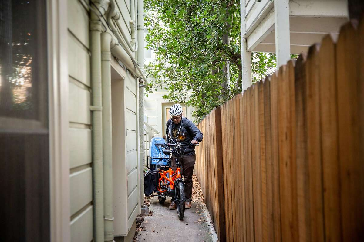 Ed Parillon takes out his bike from his home, Friday, Jan. 3, 2020, in San Francisco, Calif. Parillon runs errands and uses a bike instead of a car.