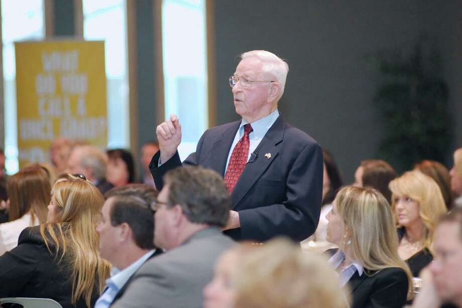 """I get out of bed every morning with a mission, a plan to do something special,"" says Pearland Mayor Tom Reid, shown speaking during a 2014 state of the city luncheon by the Pearland Chamber of Commerce. Photo: Kirk Sides / The Journal / The Journal"