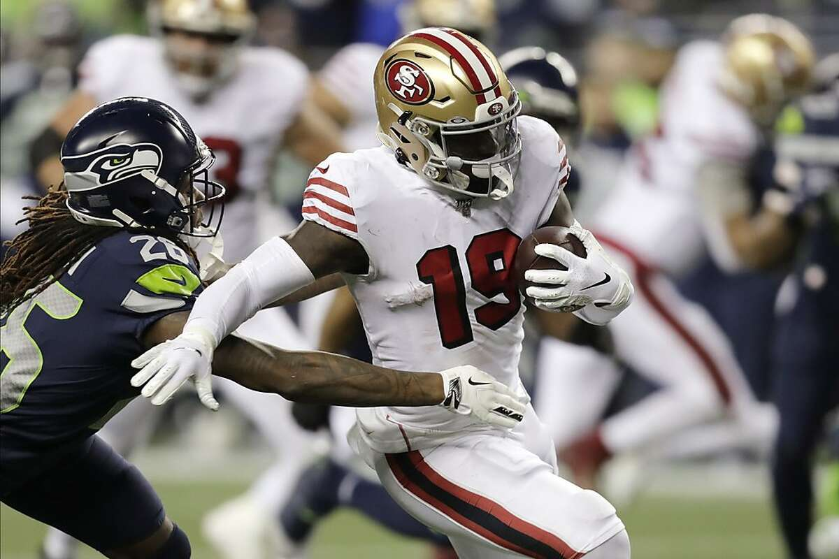 San Francisco 49ers wide receiver Deebo Samuel carries against the Seattle Seahawks during the second half of an NFL football game, Sunday, Dec. 29, 2019, in Seattle. (AP Photo/Stephen Brashear)