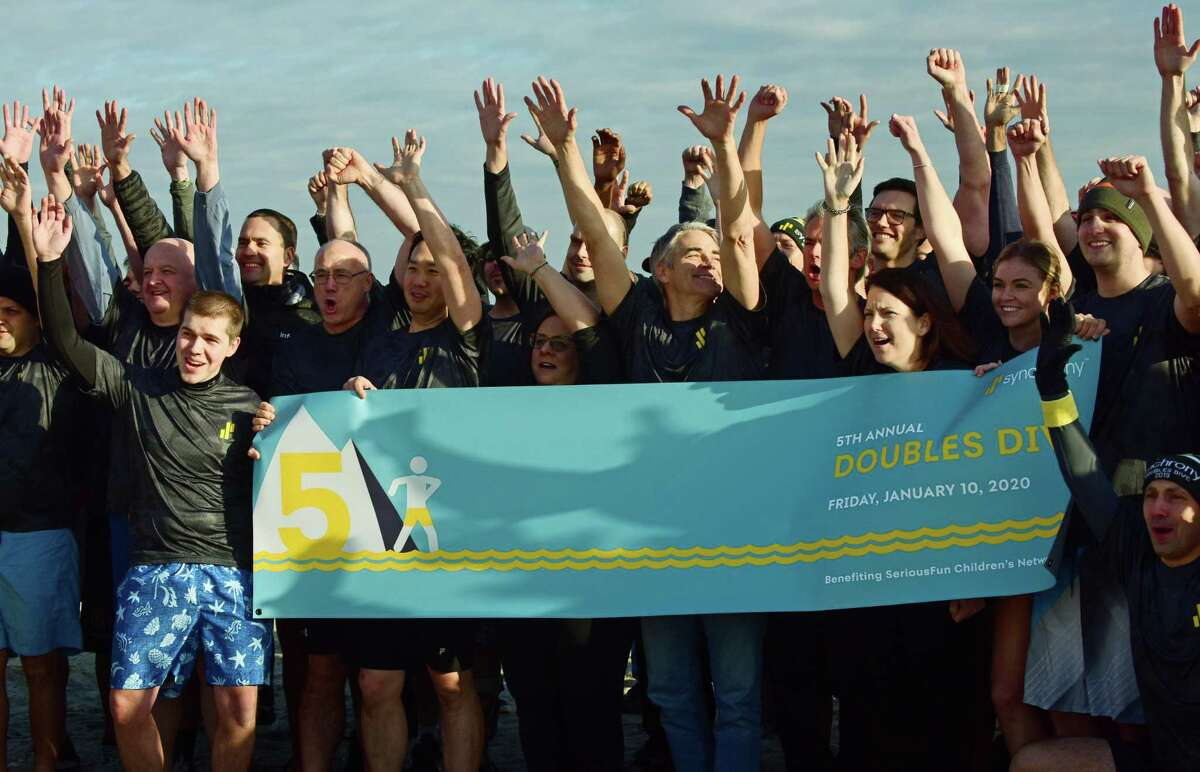 More than 100 employees of Synchrony, a premier consumer financial services company, participate in the fifth annual Doubles Dive Friday, January 10, 2020, plunging into the chilly waters to raise money for charity at Compo Beach in Westport, Conn. The benefit event was conceived in 2015 by Synchrony president Brian Doubles and has grown to 14 other Synchrony sites throughout the U.S., India and the Philippines. Funds raised from this years Doubles Dive will go to SeriousFun Children's Network, a global community of 30 camps and programs providing life-changing experiences to children living with serious illnesses and their families free of charge.