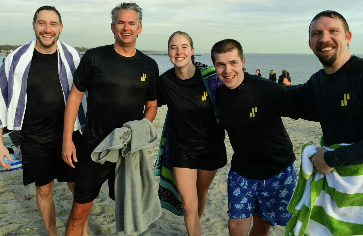 President Brian Doubles, second from left, joins more than 100 employees of Synchrony, a premier consumer financial services company, as they participate in the fifth annual Doubles Dive Friday, January 10, 2020, plunging into the chilly waters to raise money for charity at Compo Beach in Westport, Conn. The benefit event was conceived in 2015 by Synchrony president Brian Doubles and has grown to 14 other Synchrony sites throughout the U.S., India and the Philippines. Funds raised from this years Doubles Dive will go to SeriousFun Children's Network, a global community of 30 camps and programs providing life-changing experiences to children living with serious illnesses and their families free of charge.