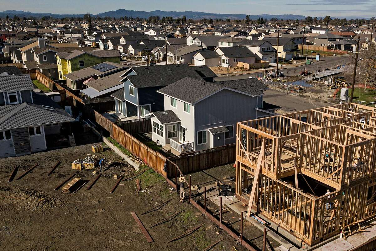 Workers build a home along Dogwood Drive in the Coffey Park neighborhood on Friday, Jan. 10, 2020, in Santa Rosa, Calif.
