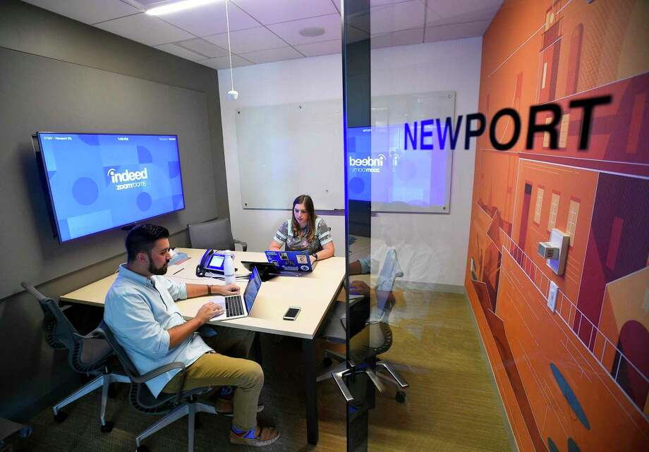 Employees of the online jobs board Indeed at work in July 2019 in Stamford, Conn. Connecticut generated a 2.1 percent increase in economic growth in the third quarter, twice the rate of three months earlier and ranking in the top half of states nationally. Photo: Matthew Brown / Hearst Connecticut Media / Stamford Advocate