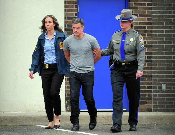 """3. 'Alibi scripts' FotisDulosand his girlfriend alsoallegedly wrote notes about what they were doing at specific times the day JenniferDulosdisappearedin an effort to """"help them remember"""" their activities, according to the warrant.  But police investigating the disappearance of the New Canaan mother said the notes, which they referred to as the """"alibi scripts,"""" included information proven to be inaccurate and witnesses later determined to be false, the warrant states.  According to the warrant, police interviewedTroconison June 2 — one day after she andFotisDuloswere first arrested — and """"provided substantial amount of information which was self-contradictory and did not bear up under the scrutiny of the investigation.""""  For example,Troconiscould not account forFotisDulos' whereabouts until around lunchtime on the day his wife disappeared, the warrant said.FotisDulos' lawyer had previously contendedTroconis could alibi his client. Photo: Christian Abraham / Hearst Connecticut Media / Connecticut Post"""
