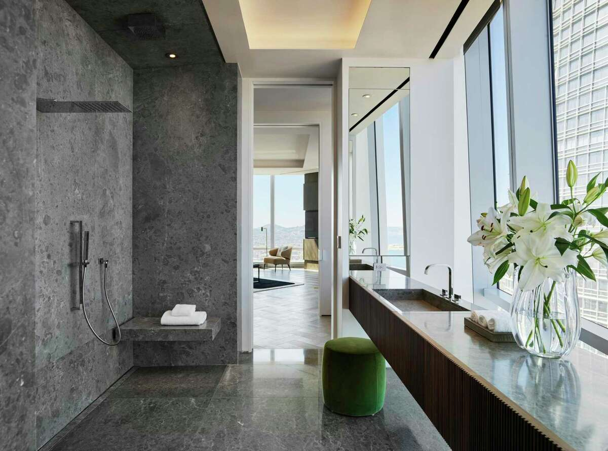The master suite within the grand penthouse at 181 Fremont features a pair of spa-caliber bathrooms with superlative finishes.