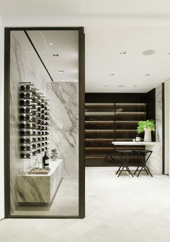 <p>The grand penthouse's dining room at 181 Fremont includes a wine display and tasting bar.</p>