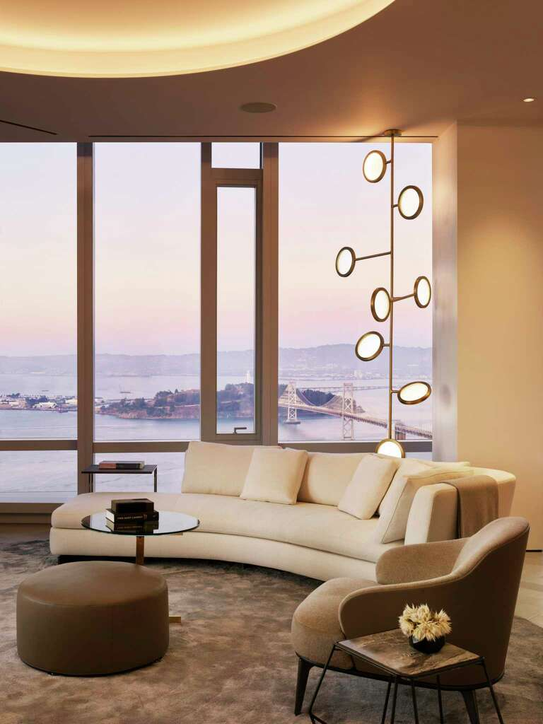 <p>The grand penthouse of 181 Fremont includes a wine display with a tasting bar.</p>