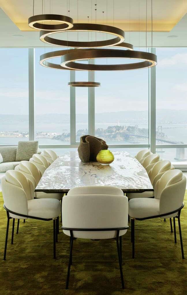 <p>A custom table and chandelier compliment the views to Treasure Island and the Bay Bridge from the dining room.</p>