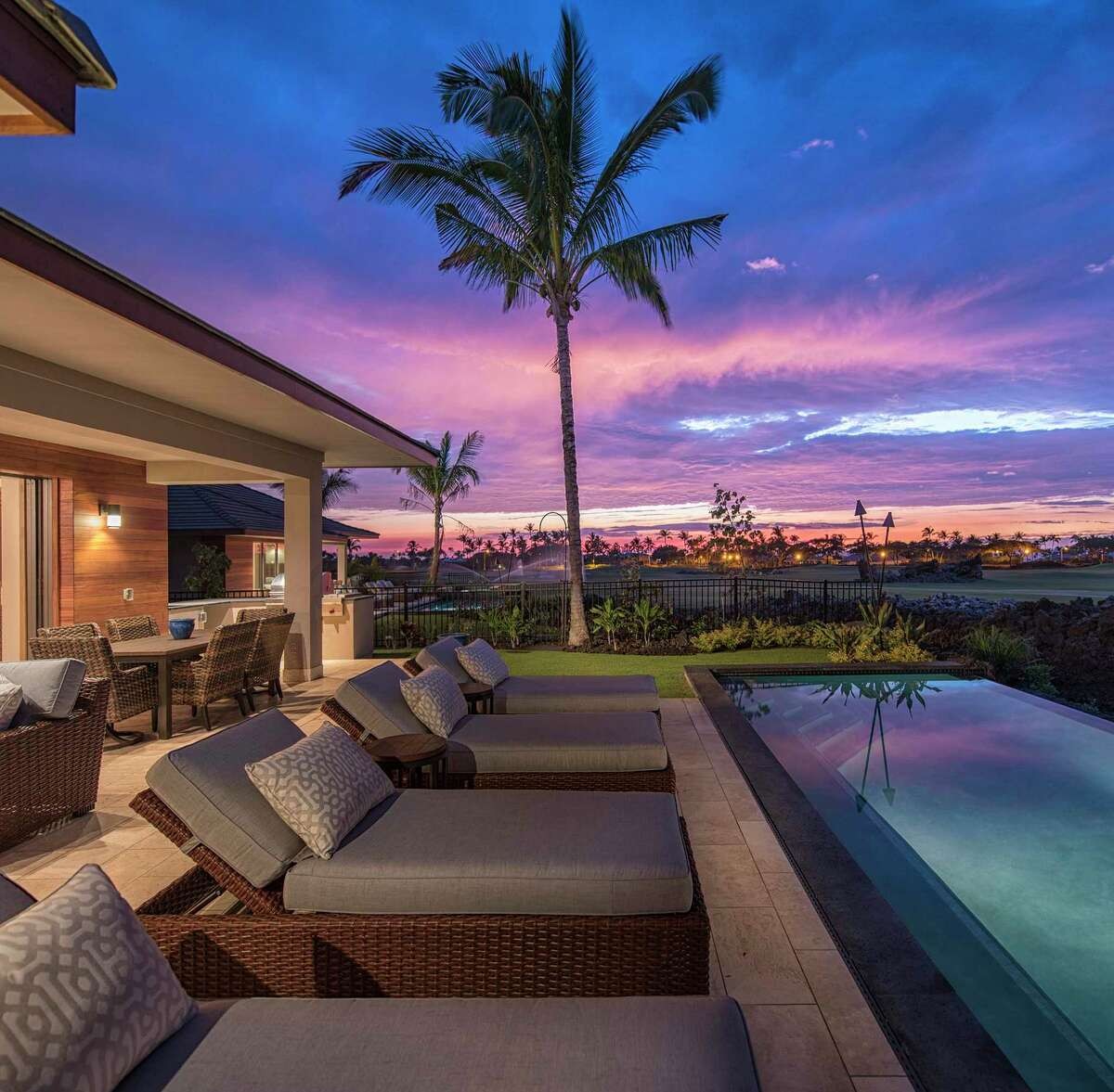 This twilight shot showcases a layout that's conducive to indoor/outdoor living at the Hawaii home.