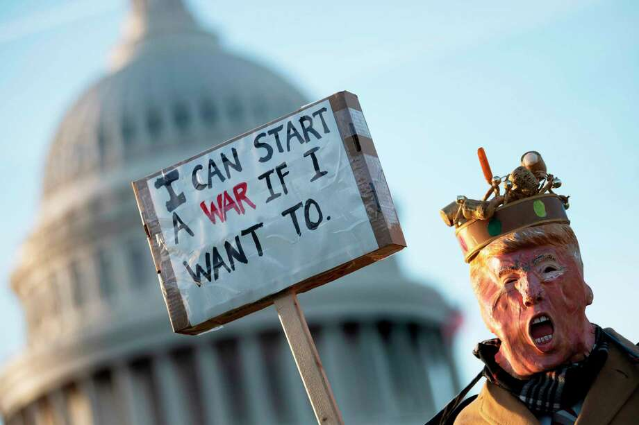 "A demonstrator dressed as President Donald Trump stands in front of the U.S. Capitol in Washington, DC, on Jan. 9 during a rally on ""No War with Iran."" Photo: Jim Watson / AFP Via Getty Images / AFP or licensors"