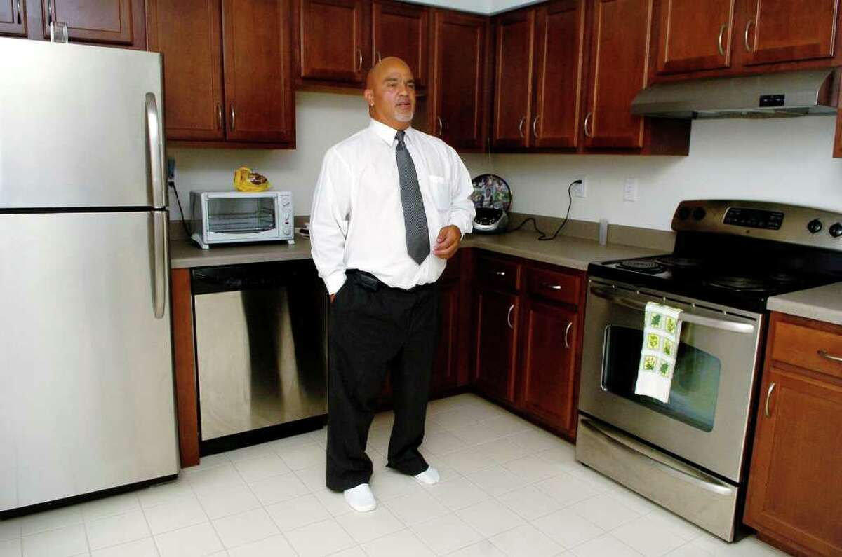 Edward Miranda at home in his apartment in the Fairgate complex on Fairfield Ave in Stamford, Conn. on Thursday August 12, 2010.