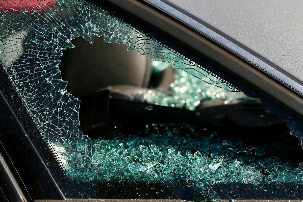 The broken glass of a rear panel window is seen on a car waiting to be replaced at Auto Glass Now on Friday, January 10, 2020 in Oakland, Calif.