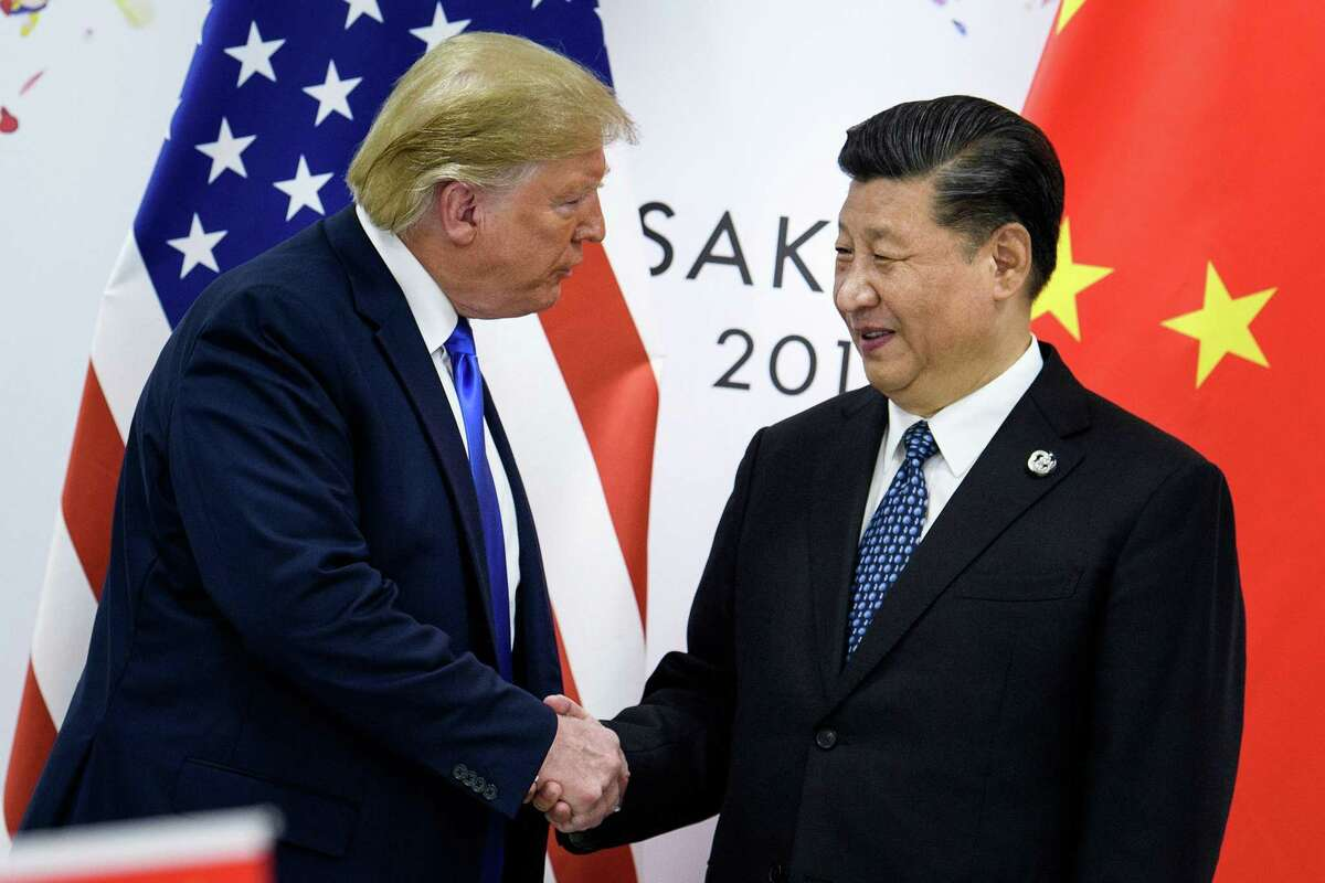 China's President Xi Jinping shakes hands with U.S. President Donald Trump before a bilateral meeting on the sidelines of the G20 Summit in Osaka on June 29, 2019. China's insatiable energy demands seem like a perfect match for U.S. energy production, but shifting geopolitics can make make matters complicated.