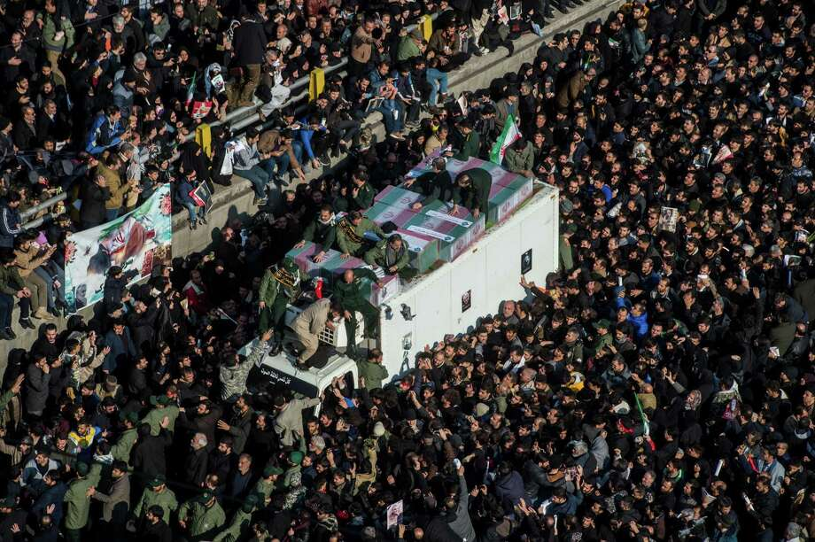 Mourners surround the coffins of Iranian Gen. Qassem Soleimani and others killed in the U.S. airstrike during a funeral Monday. Readers disagree on President Donald's Trump's decision to take out the commander.. Photo: Ali Mohammadi /Bloomberg / © 2020 Bloomberg Finance LP