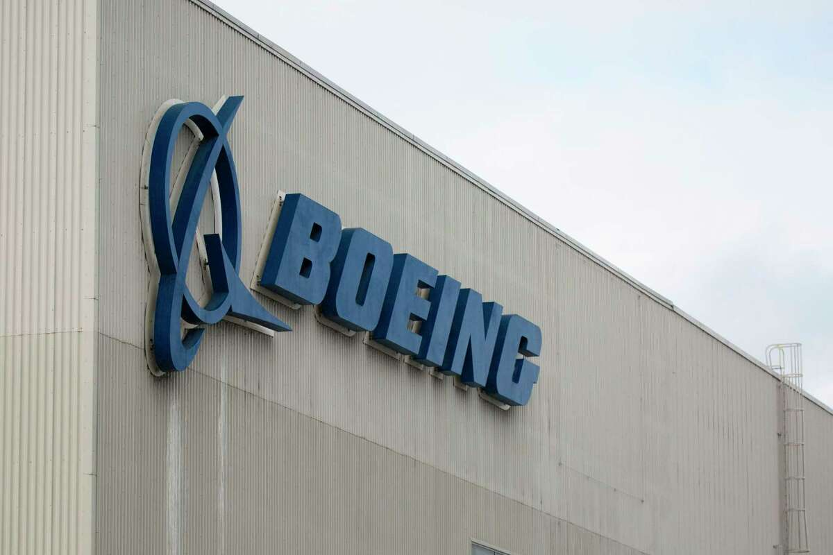 (FILES) In this file photo taken on March 12, 2019 the Boeing logo is pictured at the Boeing Renton Factory in Renton, Washington. - Boeing sent internal documents to the US Congress in December, including communications in which employees mocked regulators and brag that they can certify the 737 MAX with minimal pilot training. Among these messages are exchanges between test pilots at Boeing who report problems with flight simulators that replicate actual flight conditions, the aircraft manufacturer explains in a statement released on January 9, 2020. (Photo by Jason Redmond / AFP) (Photo by JASON REDMOND/AFP via Getty Images)