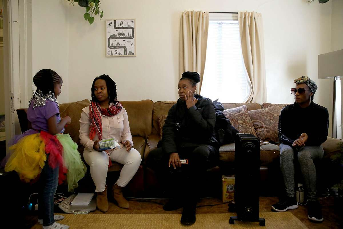 (From left to right) Demi Johnson, 5, converses with Carroll Fife, Tolani King, and Dominique Walker inside the Magnolia Street home in Oakland, Calif., on Friday, January 10, 2020.