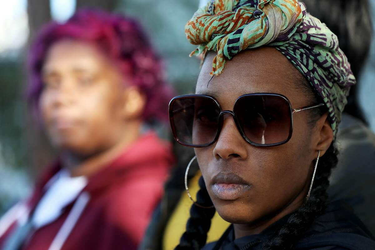 Dominique Walker attends a press conference outside the Magnolia Street home she's been occupying since November 2019, in Oakland, Calif., on Friday, January 10, 2020.