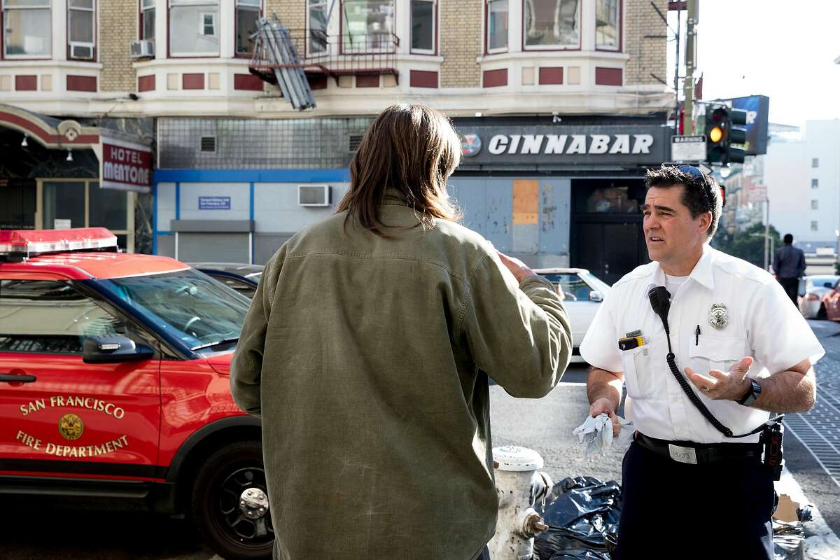 EMS-6 Captain Scott Eberhart walks the Tenderloin to identify at-risk homeless people during a high-intensity care team shift managing and facilitating high-impact patient cases of those suffering from addiction and mental illness on the streets in San Francisco, Calif. Friday, Jan. 10, 2020.