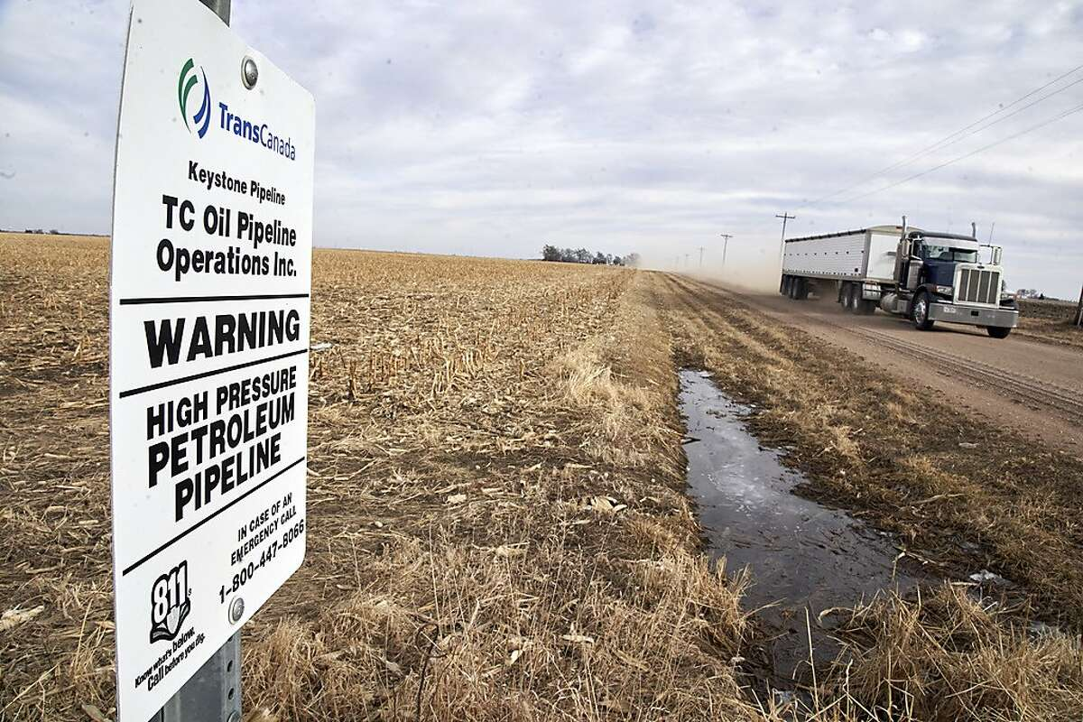 A grain truck drives past a Keystone pipeline pumping station near Milford, Neb., Thursday, Jan. 9, 2020. President Donald Trump took action Thursday to clear the way and speed up development of a wide range of commercial projects by cutting back federal review of their impact on the environment. The aim of the planned overhaul of the National Environmental Policy Act, or NEPA, is to streamline environmental approvals for major construction efforts like highways, airports, pipelines and power plants. (AP Photo/Nati Harnik)
