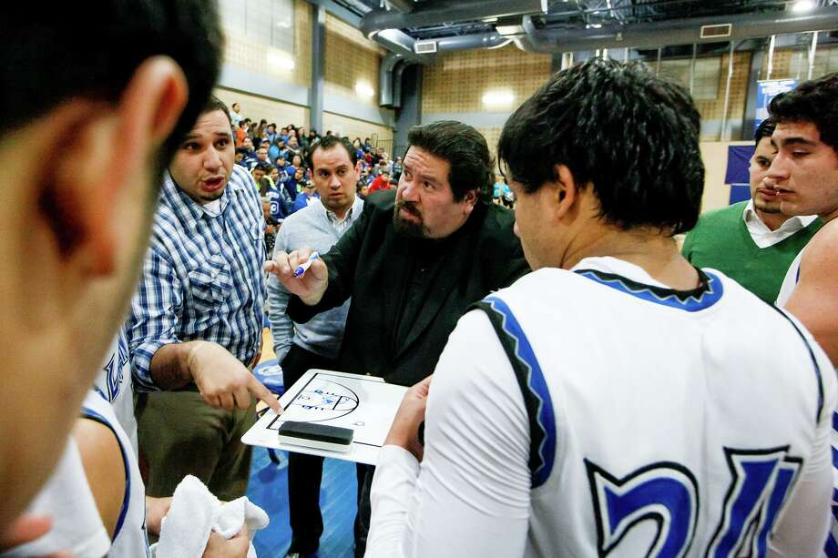 Lanier basketball coach Rudy Bernal (center) and assistant coach Martin Cardenas (left) talk to the team during a time out during a 2014 game. Lanier is the area's most successful boys basketball program with 11 state tournament appearances and championships in 1943 and 1945 under legendary coach Nemo Herrera. Bernal guided the Voks to their fourth state tournament in 2001. Photo: Staff File Photo / Express-News 2013