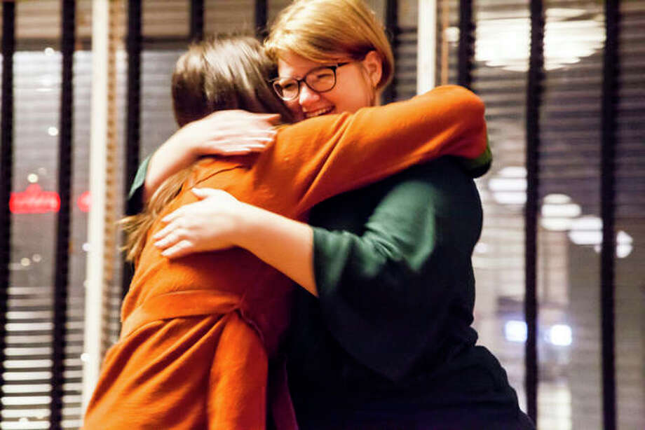 """Sara McGibany, executive director of Alton Main Street, left, hugs Alton Main Street's """"Volunteer of the Year,"""" Laura Blair, during Thursday's Annual Appreciation Party in Alton. Photo: Jeanie Stephens