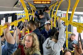 Riders pack onto a 38-Geary Muni bus during rush hour in San Francisco, Calif. Thursday, July 18, 2019.