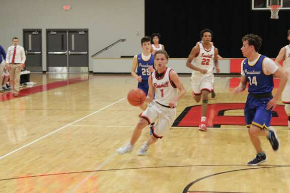 Rosehill Christian beat Providence Classical 68-24 in the TAPPS 3A District 6 opener, Jan. 7, at Rosehill Christian High School. Jacob Anderson, center, finished with 18 points for the Eagles.