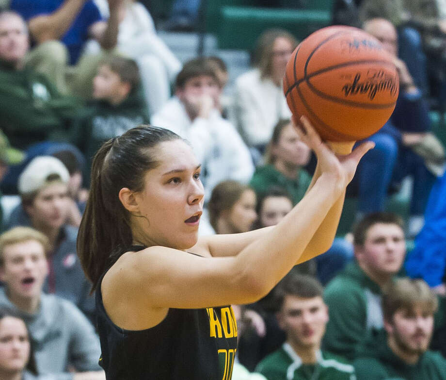 Dow High's Abby Rey takes a shot during a game against Freeland earlier this season. Rey led the Chargers to a 48-29 win over Bay City Western on Friday in what Dow coach Kyle Theisen called his team's most complete effort of the season thus far. Photo: Daily News File Photo