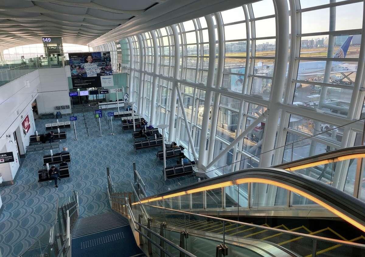 Escalator down to departure gates at Tokyo Haneda Airport International Terminal (3)