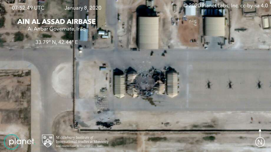 FILE - This satellite image provided by the Middlebury Institute of International Studies and Planet Labs Inc., on Wednesday, Jan. 8, 2020 shows damage caused by an Iranian missile strike at the Ain al-Asad air base in Iraq. Iran's actions were in response to the U.S. killing of Revolutionary Guard Gen. Qassem Soleimani. On Friday, Jan. 20, 2020, The Associated Press reported on stories circulating online incorrectly asserting there had been casualties from the attack. Both U.S. and Iraqi forces confirmed soon after the missiles were launched that no casualties were reported, and in his comments about the attack President Donald Trump said no Americans or Iraqis were harmed. (Planet Labs Inc./Middlebury Institute of International Studies via AP) Photo: Associated Press / Planet/Middlebury Institute of International Studies