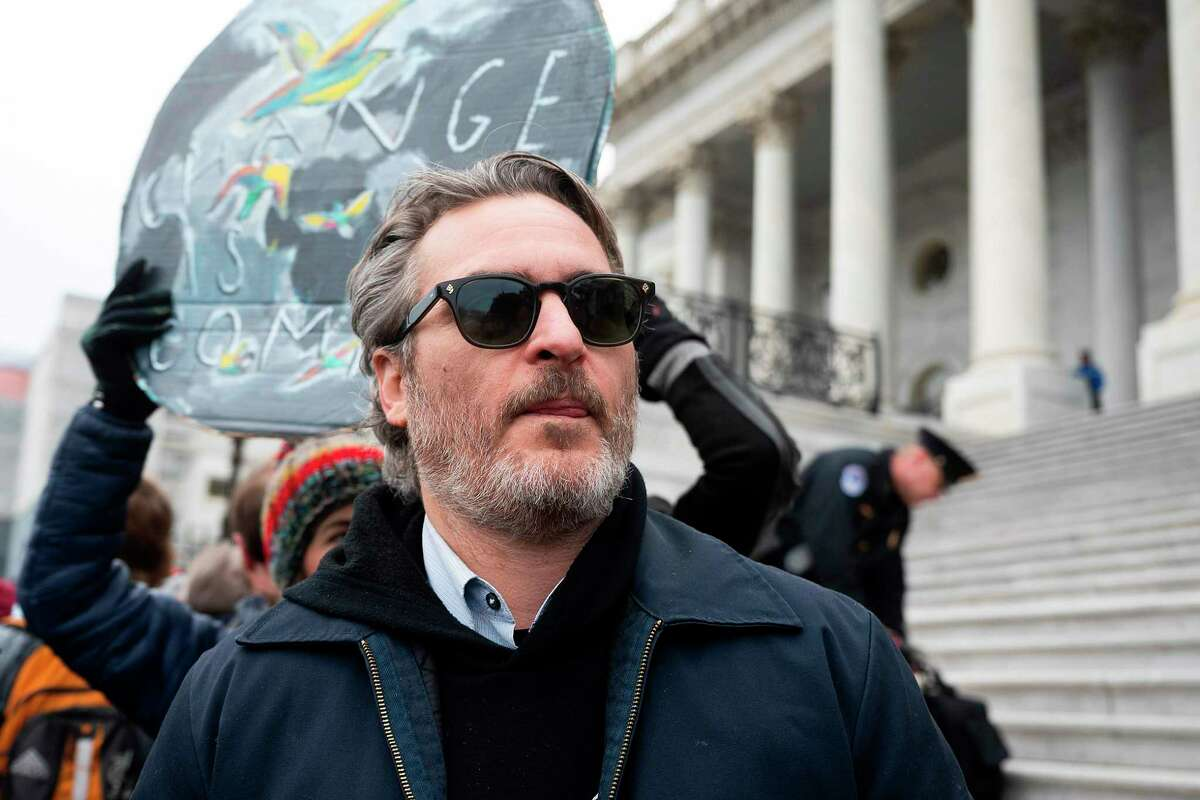 Actor Joaquin Phoenix (C) demonstrates during Fonda-Fire Drill Friday with actress Jane Fonda (not pictured) outside the Capitol for the last time protesting fossil fuel companies in Washington, DC, on January 10, 2020. (Photo by JIM WATSON / AFP) (Photo by JIM WATSON/AFP via Getty Images)