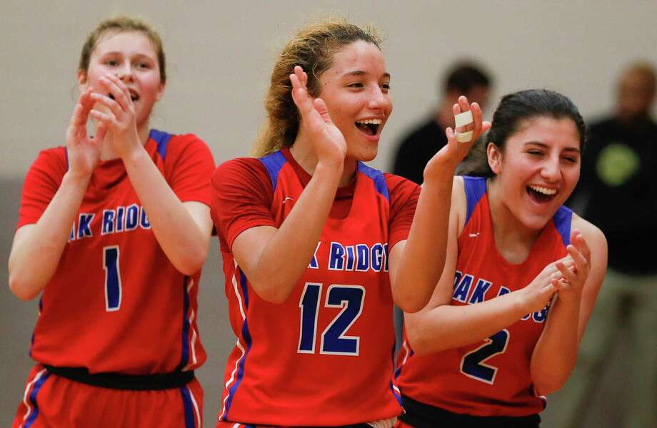Oak Ridge point guard Nicole Petrakovitz (1), shooting guard Mersadez Nephew (12) and guard Alyssa Castro (2) react after handing Conroe their first distrist loss of the season after a District 15-6A high school basketball game at Conroe High School, Friday, Jan. 10, 2020, in Conroe. Photo: Jason Fochtman, Houston Chronicle / Staff Photographer / Houston Chronicle © 2020