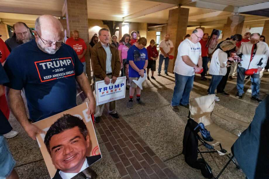 Protesters pray for comedian George Lopez and his fans as Republicans rally outside the Beaumont Civic Center across the street from the George Lopez event at the Julie Rogers Theatre on Friday, January 10, 2020 in protest of some comments made by the comedian.